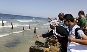 Palestinians throw roses in the Mediterranean