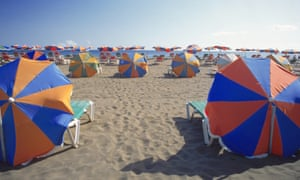 Rows of parasols on the beach.