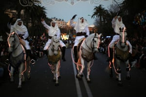 Horse riders wave to the crowd during the traditional Epiphany parade in Malaga, Spain