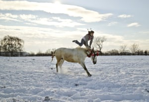 A horse and rider warm up before an Epiphany horse race in Pietrosani, Romania