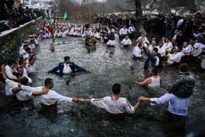 Men dance in the icy winter waters of the Tundzha river as part of Epiphany celebrations in in Kalofer