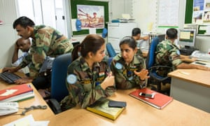 Majors Shikha Mehrotra, left, and Neha Khajuria, two of four women out of 5,000 total serving in the Indian brigade of the UN peacekeeping force in DR Congo in Goma