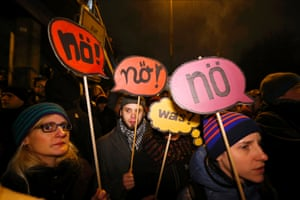People take part in a protest against the march of the Pegida movement in Cologne
