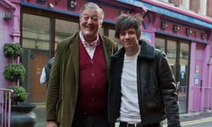 Stephen Fry and fiance Elliot Spencer leave Fry's house in central London on Tuesday afternoon after Fry announced their engagement.