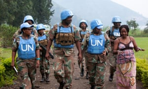 "Major Steven Matodon, public information officer for the South African U.N. brigade, center, leads a handpicked group of mostly female U.N. soldiers on a ""mission"" to scope out a park to hold an upcoming Women's Day celebration, near Sake, D.R. Congo, July 26, 2014.   They are treating us as women whereas we are soldiers,  says Lieutenant Colonel Zukiswa Caga, the brigade's gender advisor, third from right."