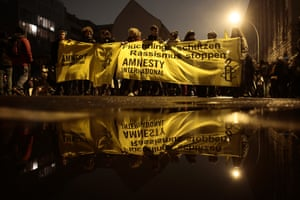 Activists from Amnesty International protest in Berlin