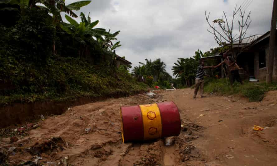 A Shell oil drum lies in the middle of the road in Bodo, Nigeria on Thursday, June 10, 2010.