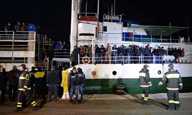 Hundreds of migrants fleeing Syria arrive at Corigliano harbour, Italy, on 2 January.