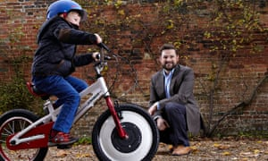 Robert Bodill watches  a young cyclist taking the Jyrobike for a spin.