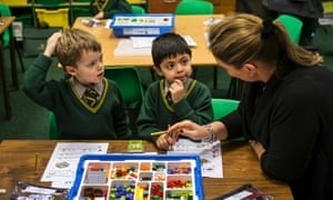 Sebastian and Amar learn their sums with Lego at Birchfield school, with their teacher Emma Grant-King.