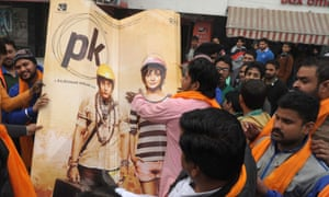 Activists prepare to burn a PK poster for allegedly offending Shiv Sena religious sentiments.