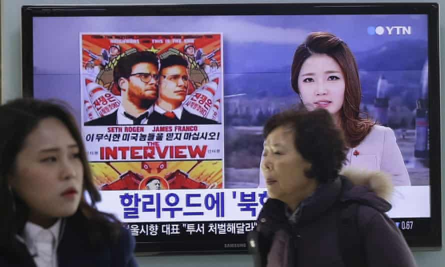 A TV screen at a train station in Seoul features news coverage of controversy surrounding the Hollywood film The Interview.
