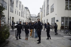 Police forces gather in street outside Charlie Hebdo offices