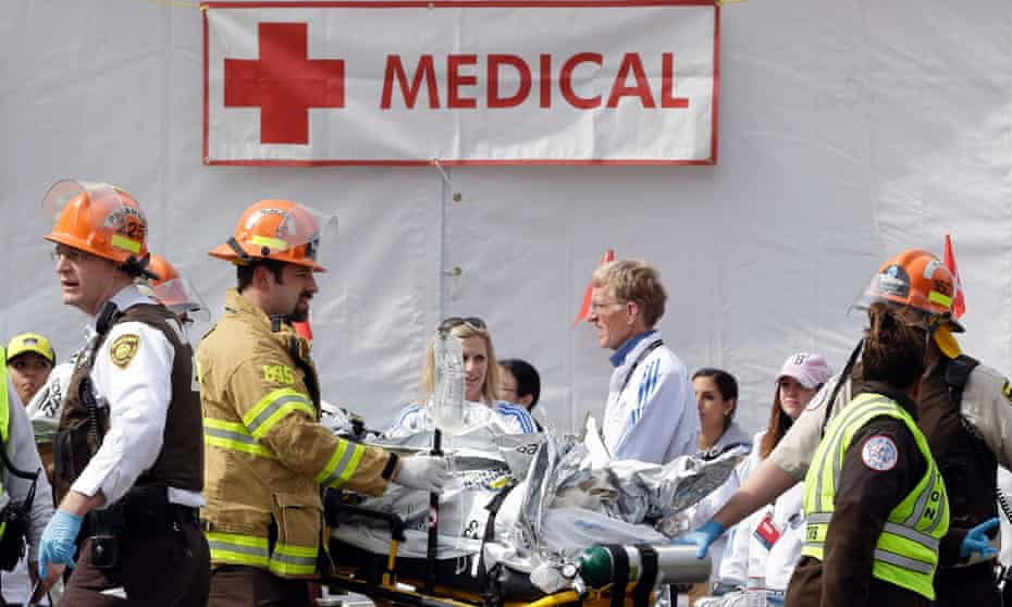 Medical personnel work outside the medical tent in the aftermath of two blasts which exploded near the finish line of the Boston Marathon.