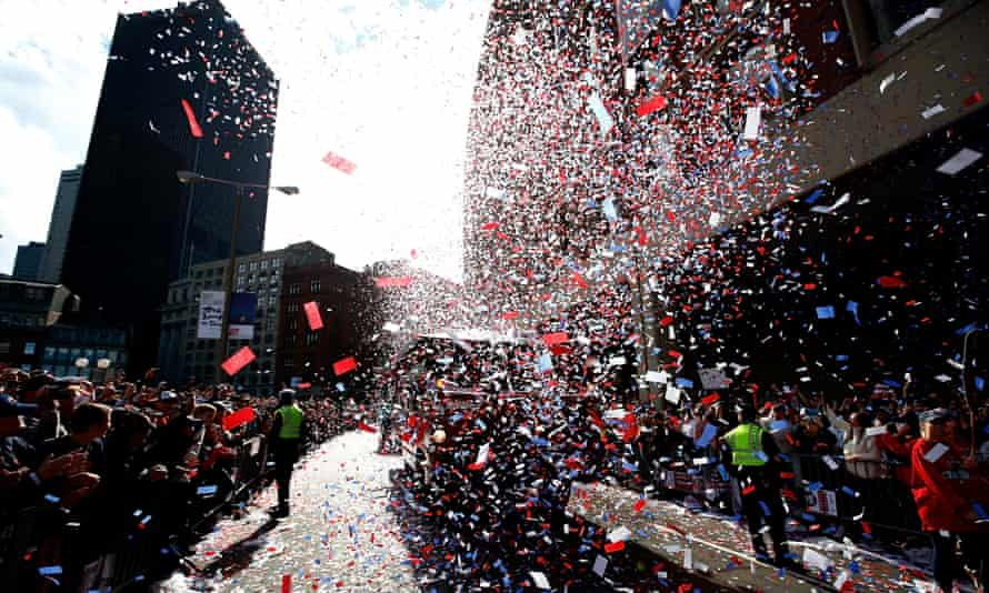 Crowds line the streets of Boston again to cheer the victorious Boston Red Sox baseball team in November 2013.