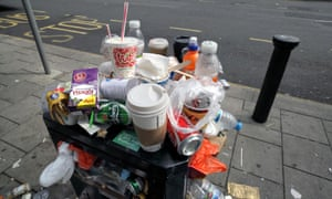 Overflowing litter bin in Brighton city centre.l