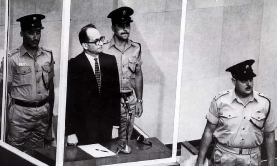 Eichmann in court showing no reaction when confronted with his terrible actions.