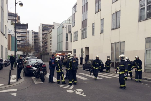 Police and firefighters outside the Charlie Hebdo offices in Paris.