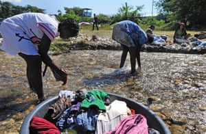 Against the background of the UN stabilisation mission in Haiti (Minustah) where the cholera epidemic originated women from Mirebalais, 60km north east of Port-au-Prince, do their washing.