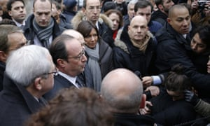 Hollande speaks to the press after arriving at the offices of Charlie Hebdo.