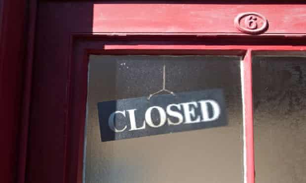 Closed sign in shop door window
