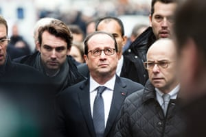 President Francis Hollande arrives at the offices of satirical newspaper Charlie Hebdo in Paris