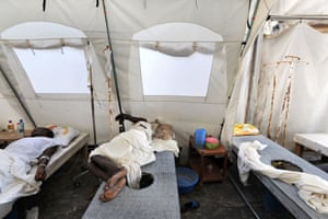 Two of the approximately 25,000 people who were infected by the disease in 2014 receive treatment at the cholera treatment centre in Mirebalais.