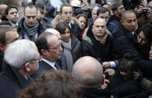 Francois Hollande speaks to the press after arriving at Charlie Hebdo offices in Paris