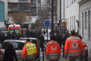Ambulances and police officers outside of the Charlie Hedbo offices