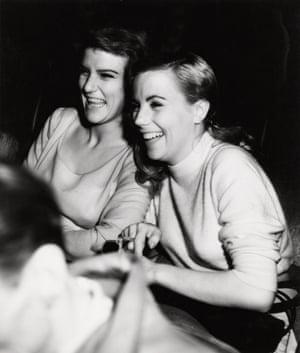 Girls laughing at movie, New York