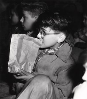 Boy eating out of a paper bag