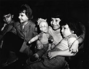 Girls in movie theatre with doll