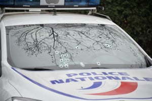 Bullet marks seen on police vehicles outside the Charlie Hebdo office