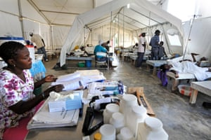 This cholera treatment centre in Mirebalais is run by Partners in Health. It is not subject to the shortages and unpaid salaries of government facilities but the closure of other clinics mean people are often extremely sick when they arrive.