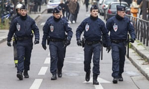 Police officers close to the offices of the French satirical newspaper Charlie Hebdo in Paris.