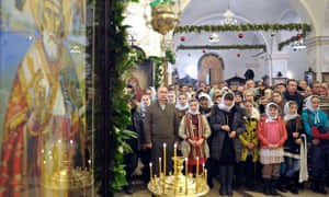 Vladimir Putin attends midnight mass in Voronezh