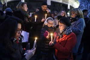 People light candles in support of the victims of the Charlie Hebdo attack at the Place de la Republique
