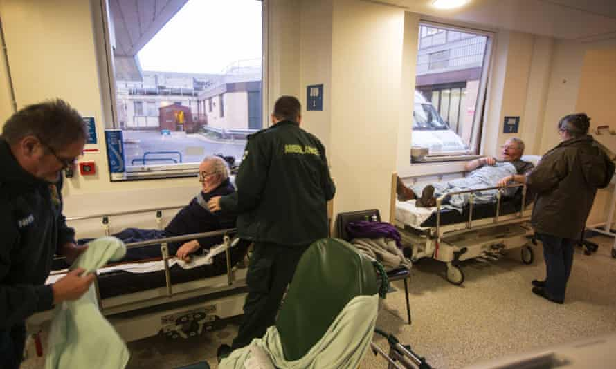 Patients await treatment in beds on corridors in the A&E unit at Addenbrooke's.