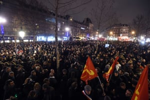 People gather at the Place de la Republique in Paris this evening