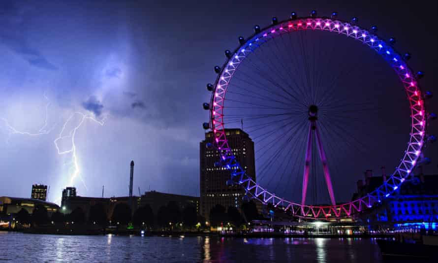 Lightning strikes behind the London Eye in central London on Tuesday July 23, 2013.