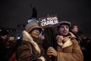 A couple at the Place de la Republique in Paris
