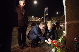 Danish defence minister Nicolai Wammen lights a candle in front of the French Embassy in Copenhagen