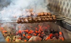 Kebabs cooking over coals at Super Ocakbasi, Stoke Newington, London