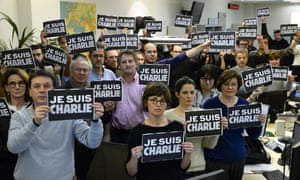 Journalists from the french new agency AFP hold placards reading Je Suis Charlie at their offices in Paris