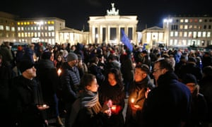 People gather to mourn for the victims of the attack on Charlie Hedbo french newspaper, in front of the Brandenburg Gate in Berlin