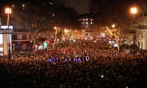 People gather in Paris to pay respects to the victims of the attack on Charlie Hebdo in Paris