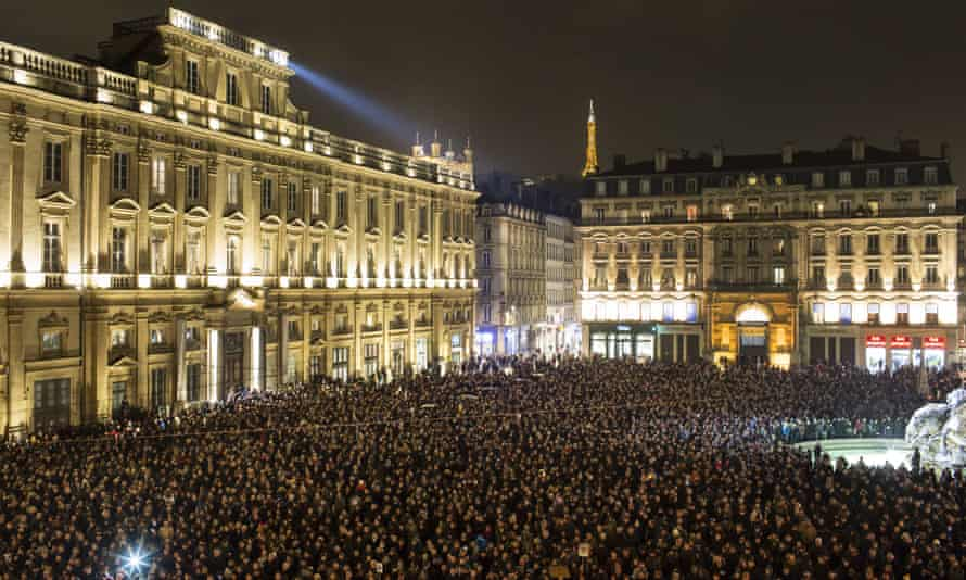 Thousands of people gather in Lyon for a moment of silence to pay their respects to the victims.