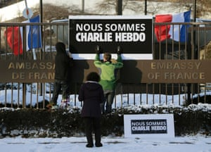A sign reading  Nous sommes Charlie Hebdo is erected by embassy personnel at the front gate of the French Embassy in Washington