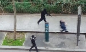 Gunmen shoot a wounded police officer (right) on the ground at point-blank range as they flee the offices of French satirical newspaper Charlie Hebdo.