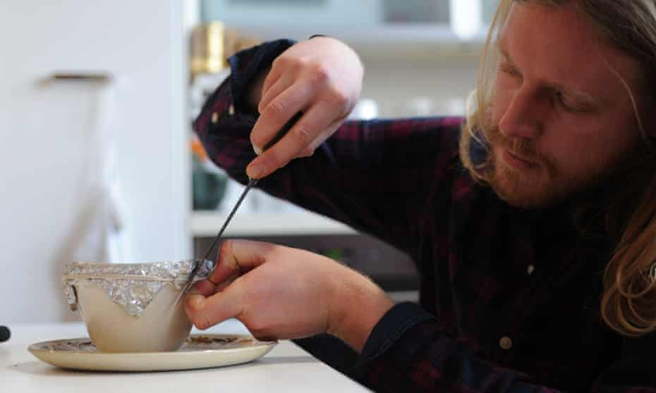 a man cutting the string on a steamed pudding